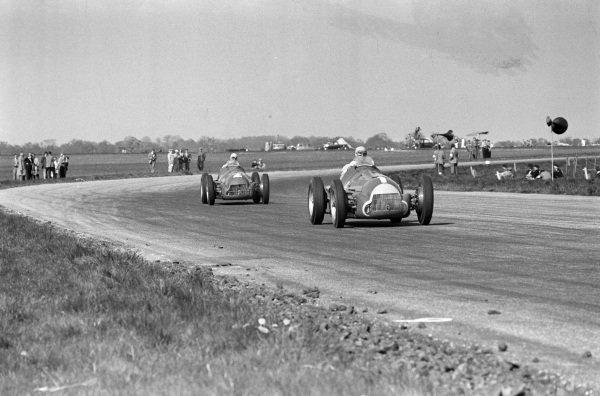 Juan Manuel Fangio, Alfa Romeo 158, leads Giuseppe Farina, Alfa Romeo 158.