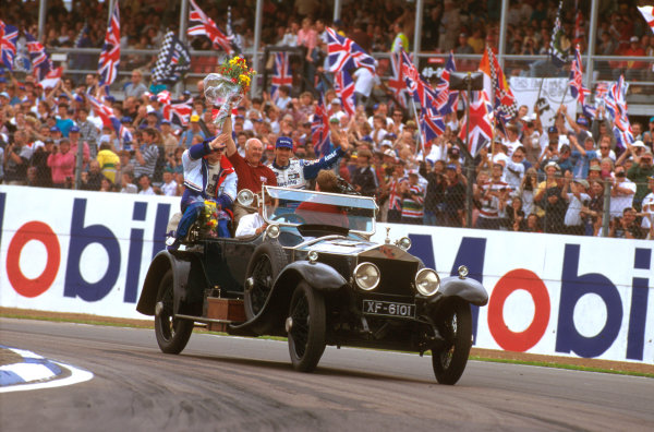 Silverstone, England.12-14 July 1996.Murray Walker joins Damon Hill and Jacques Villeneuve on the drivewrs parade lap, because he thought that it might be his last british Grand Prix. Ref-96 GB 25.World Copyright - LAT Photographic