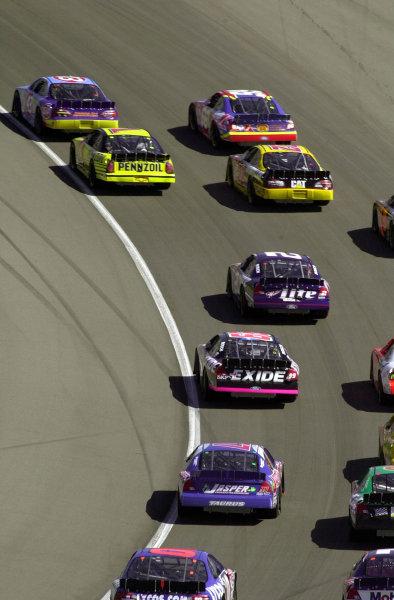 A train of cars headed by John Andretti (43) races through turn one.NAPA Auto Parts 500 at California Speedway, Fontana, California, USA, 30 April,2000.-F Peirce Williams 2000 LAT PHOTOGRAPHIC USA