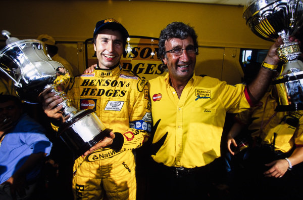 Heinz-Harald Frentzen celebrates victory with Eddie Jordan.