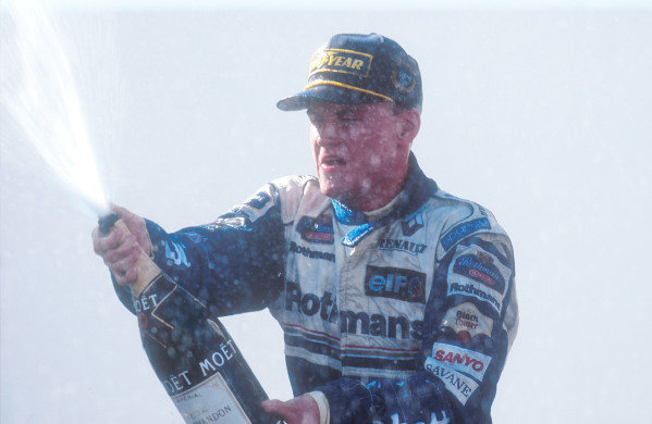 1995 Portuguese Grand Prix. Estoril, Portugal. 22-24 September 1995. David Coulthard (Williams Renault) sprays the champagne on the podium after taking his maiden Grand Prix win. Ref-95 POR 02. World Copyright - LAT Photographic