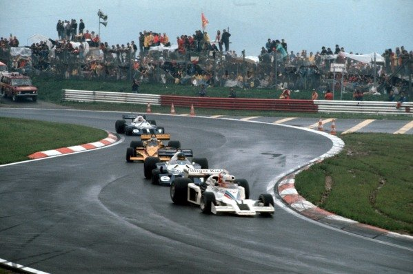Alan Jones, Shadow DN8 Ford, leads Ronnie Peterson, Tyrrell P34 Ford, Jean-Pierre Jarier, Penske PC4 Ford, and Patrick Depailler, Tyrrell P34 Ford.