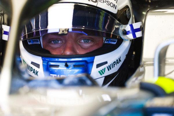 Valtteri Bottas, Mercedes AMG F1, in cockpit with helmet visor raised.