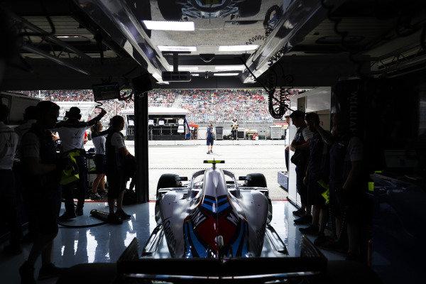 Sergey Sirotkin, Williams FW41 Mercedes, exits his pit garage.