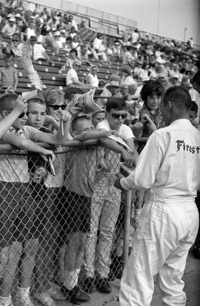 Parnelli Jones signs autographs for fans.