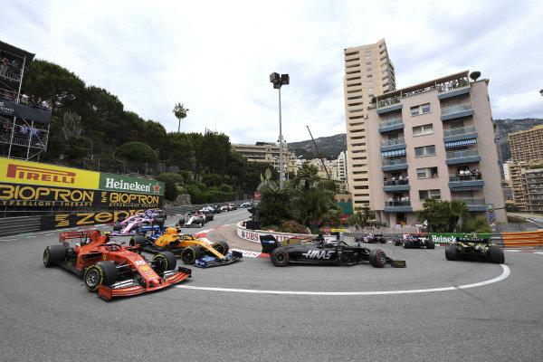 Romain Grosjean, Haas VF-19, leads Charles Leclerc, Ferrari SF90, Lando Norris, McLaren MCL34, and Lance Stroll, Racing Point RP19