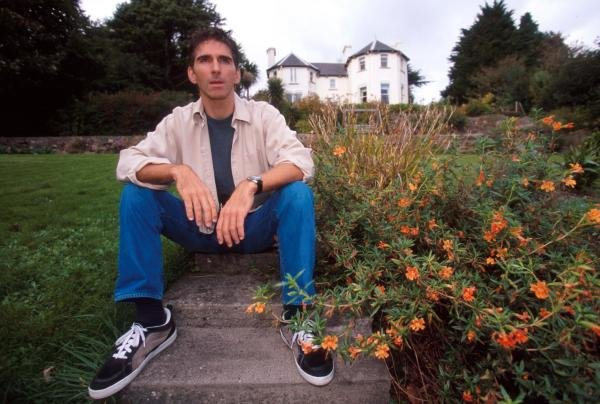 Damon Hill (GBR) relaxes in his garden outside his home.
