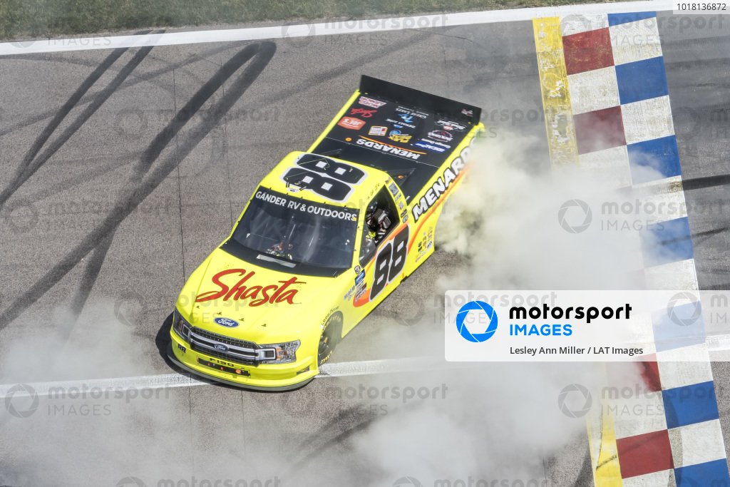 #88: Matt Crafton, ThorSport Racing, Ideal Door/Menards Ford F-150 celebrates with a burn out