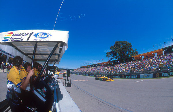 1993 Australian Grand Prix.Adelaide, Australia.5-7 November 1993.Michael Schumacher (Benetton B193B Ford) passes his pitboard. He exited the race with an engine failure. Ref-93 AUS 13.World Copyright - LAT Photographic