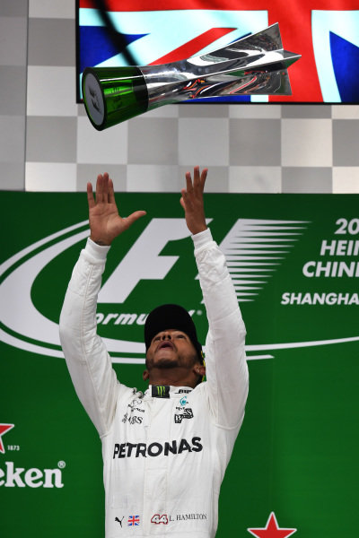Race winner Lewis Hamilton (GBR) Mercedes AMG F1 celebrates on the podium the trophy at Formula One World Championship, Rd2, Chinese Grand Prix, Race, Shanghai, China, Sunday 9 April 2017.