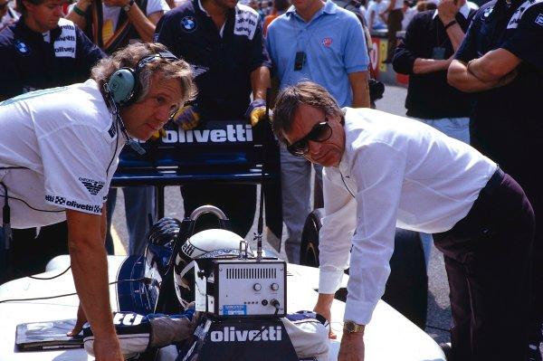 1986 Italian Grand Prix.Monza, Italy.5-7 September 1986.Brabham team boss Bernie Ecclestone and Chief Mechanic Charles Whiting discuss things with driver Riccardo Patrese (Brabham BMW).Ref-86 ITA 04.World Copyright - LAT Photographic