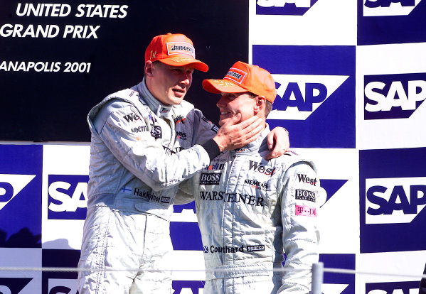 2001 American Grand Prix - RaceIndianapolis, United States. 30th September 2001.Race winner Mika Hakkinen, West McLaren Mercedes MP4/16, and 3rd place finisher David Coulthard, share the podium.World Copyright: Steve Etherington/LAT Photographicref: 18mb Digital Image