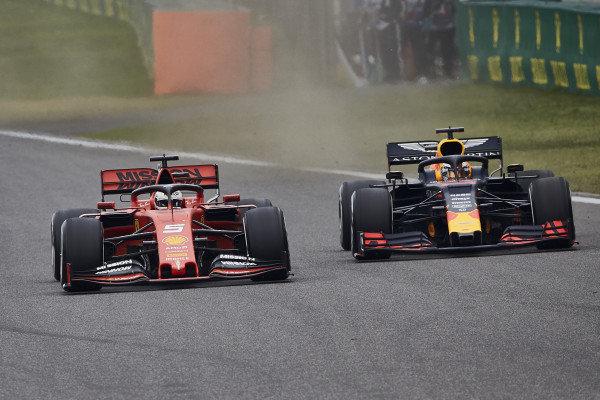 Sebastian Vettel, Ferrari SF90, battles with Max Verstappen, Red Bull Racing RB15