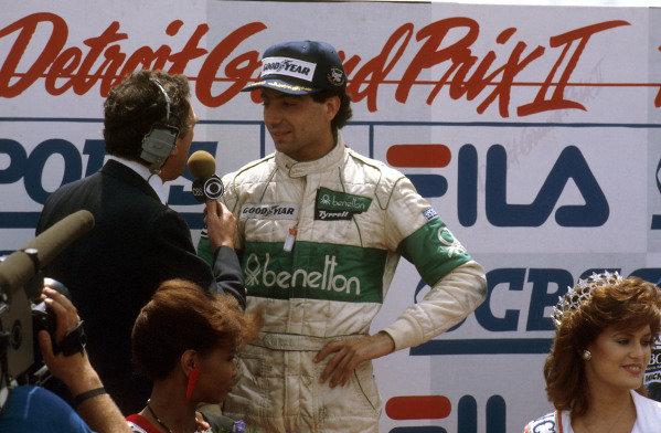 1983 United States Grand Prix East.Detroit, Michigan, USA.3-5 June 1983.Michele Alboreto (Tyrrell Ford) 1st position, on the podium.Ref-83 USA 05.World Copyright - LAT Photographic