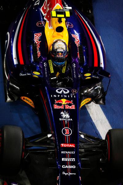 Yas Marina Circuit, Abu Dhabi, United Arab Emirates. Saturday 22 November 2014. Daniel Ricciardo, Red Bull Racing RB10 Renault, arrives in Parc Ferme after Qualifying. World Copyright: Charles Coates/LAT Photographic. ref: Digital Image _J5R5169