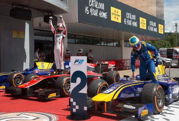 2017 FIA Formula 2 Round 2. Circuit de Catalunya, Barcelona, Spain. Sunday 14 May 2017. Nobuharu Matsushita (JPN, ART Grand Prix) celebrates victory ahead of Oliver Rowland (GBR, DAMS)  Photo: Jed Leicester/FIA Formula 2. ref: Digital Image JL1_0345
