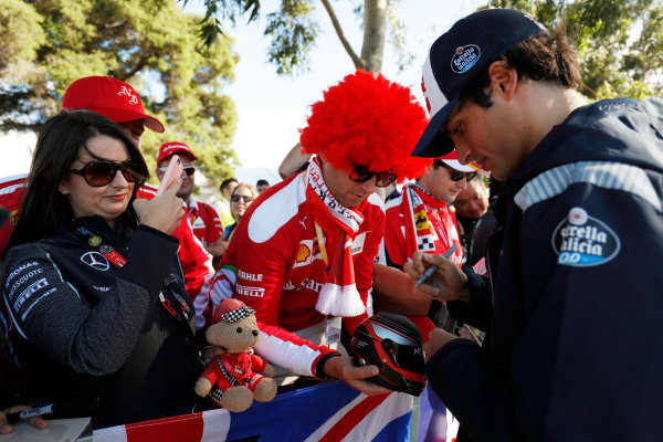 Albert Park, Melbourne, Australia. Wednesday 22 March 2017. Carlos Sainz Jr, Toro Rosso, signs autographs for fans. World Copyright: Sam Bloxham/LAT Images ref: Digital Image _W6I0171