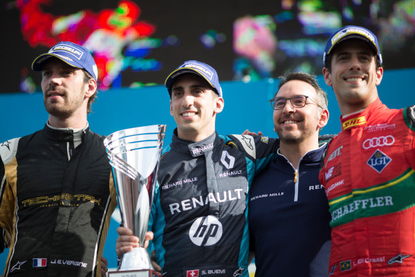 2016/2017 FIA Formula E Championship. Buenos Aires ePrix, Buenos Aires, Argentina. Saturday 18 February 2017 Sebastien Buemi (9, Renault e.dams) celebrates with Jean-Eric Vergne (25, TECHEETAH) and Lucas di Grassi (11, ABT Schaeffler Audi Sport) on the podium. Photo: Alastair Staley/LAT/Formula E ref: Digital Image 580A7561