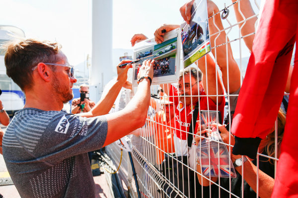 Monte Carlo, Monaco. Wednesday 24 May 2017. Jenson Button, McLaren, signs an autograph for fans. World Copyright: Andy Hone/LAT Images ref: Digital Image _ONY7193