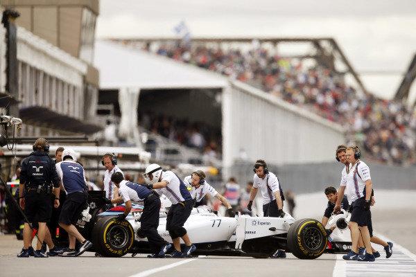 Circuit Gilles Villeneuve, Montreal, Canada. Friday 6 June 2014. Valtteri Bottas, Williams FW36 Mercedes, is returned to the garage. World Copyright: Charles Coates/LAT Photographic. ref: Digital Image _J5R9354