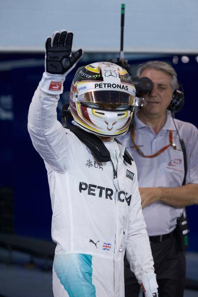 Bahrain International Circuit, Sakhir, Bahrain. Saturday 2 April 2016. Lewis Hamilton, Mercedes AMG, celebrates pole in Parc Ferme. World Copyright: Steve Etherington/LAT Photographic ref: Digital Image SNE25218