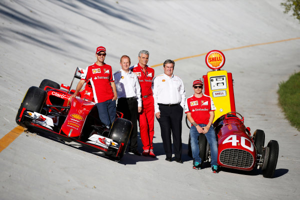 Autodromo Nazionale di Monza, Monza, Italy. Saturday 5 September 2015. Shell announce their renewed partnership with Ferrari on the Monza banking with Sebastian Vettel, Ferrari, John Abbott, Downstream Director, Shell, Mauricio Arrivabene, Team Principal, Ferrari, Istvan Kapitany, Executive Vice President of Retail, Shell and Kimi Raikkonen, Ferrari, alongside a Ferrari SF-15T and a Ferrari 166 F2 car. World Copyright: Glenn Dunbar/LAT Photographic ref: Digital Image _89P7724