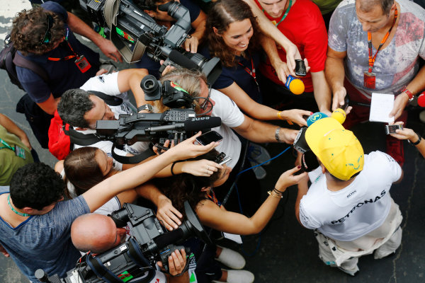 Interlagos, Sao Paulo, Brazil. Friday 13 November 2015. Lewis Hamilton, Mercedes AMG, is interviewed. World Copyright: Alastair Staley/LAT Photographic ref: Digital Image _R6T3753