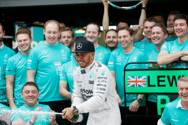 Sochi Autodrom, Sochi, Russia. Sunday 11 October 2015. Lewis Hamilton, Mercedes AMG, 1st Position, celebrates with the Mercedes team. World Copyright: Alastair Staley/LAT Photographic. ref: Digital Image _79P1531