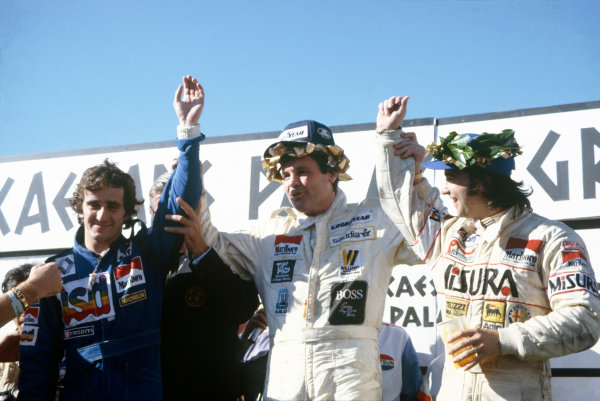 Caesar's Palace, Las Vegas, NV. 15th - 17th October 1981. Winner Alan Jones (Williams FW07C) celebrates on the podium with second placed Alain Prost (Renault RE30) and third placed Bruno Giacomelli (Alfa Romeo 179C). Ref: 81 LV 07. World Copyright: LAT Photographic