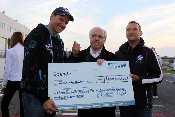 200 000 Euro for Wings for Life charity. (l-r) Heinz Kinigadner (AUT), former Motocross World Champion and KTM's Off-road Motorsports Consultant with Hans-Werner Aufrecht (GER) Chairman of the ITR and Kris Nissen (DEN), Volkswagen Motorsport Director.