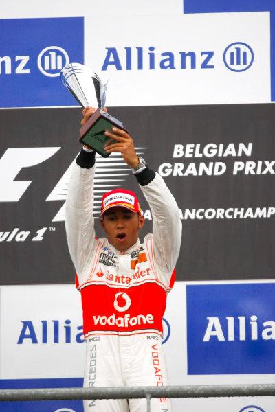 Spa-Francorchamps, Spa, Belgium 29th August 2010 Lewis Hamilton, McLaren MP4-25 Mercedes, 1st position, with his trophy. Portrait. Podium.  World Copyright: Charles Coates/LAT Photographic ref: Digital Image _26Y6800