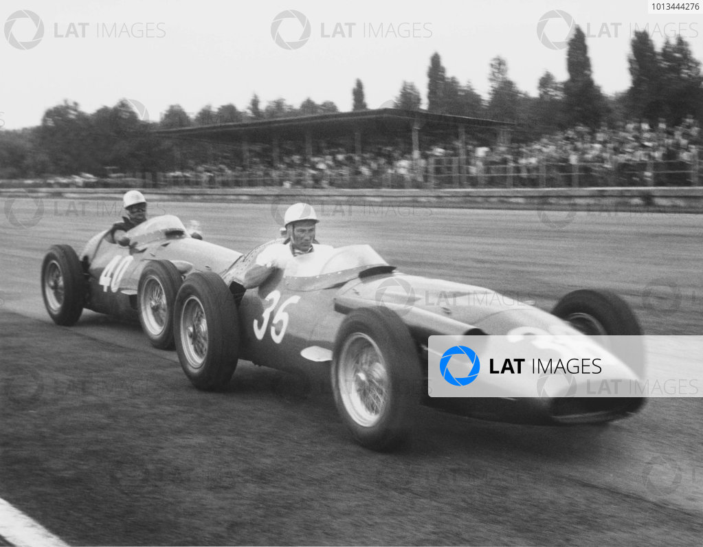 1956 Italian Grand Prix. Monza, Italy. 2 September 1956. Stirling Moss (Maserati 250F), 1st position, being push to the pits by teammate Luigi Piotti after he had run out of fuel. Ref-417/20. World Copyright - LAT Photographic