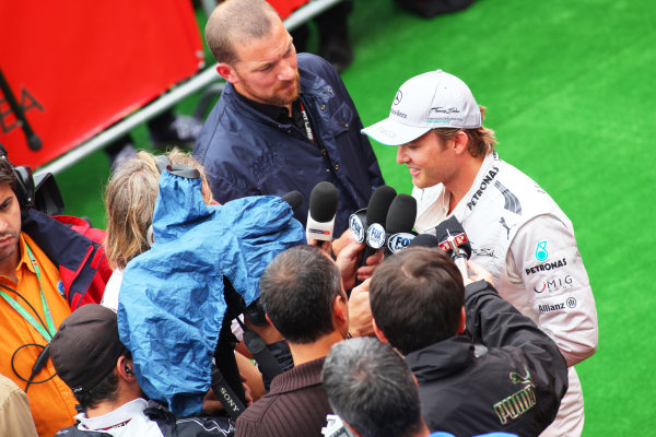 Spa-Francorchamps, Spa, Belgium. 24th August 2013. Nico Rosberg, Mercedes AMG, speaks to the press after qualifying. World Copyright: Sam Bloxham/LAT Photographic. ref: Digital Image IMG_8013.