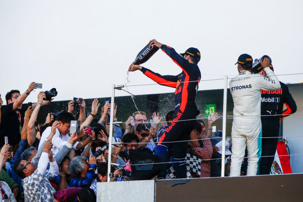 Suzuka Circuit, Japan. Sunday 08 October 2017. Daniel Ricciardo, Red Bull Racing, Lewis Hamilton, Mercedes AMG, and Max Verstappen, Red Bull Racing, celebrate with champagne on the podium. World Copyright: Andy Hone/LAT Images  ref: Digital Image _ONY8831
