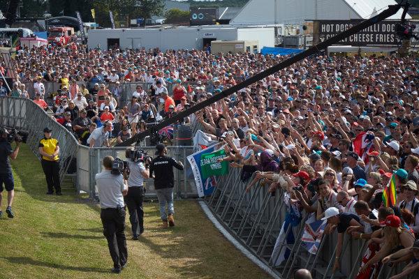 Silverstone Circuit, Northamptonshire, England. Saturday 4 July 2015. Lewis Hamilton, Mercedes AMG, meets some fans. World Copyright: Steve Etherington/LAT Photographic ref: Digital Image SNE18804