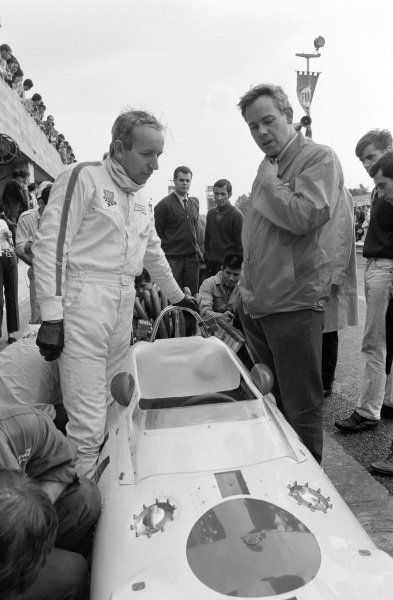 John Surtees talks with Keith Duckworth whilst standing alongside his Honda RA300.