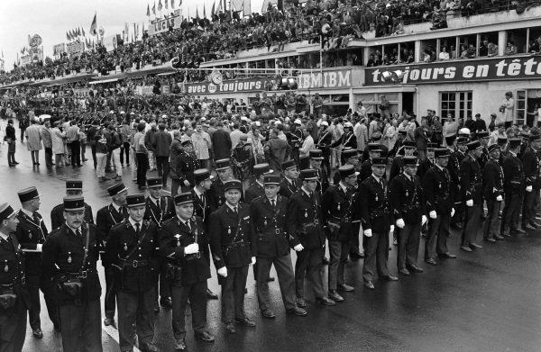 Gendarmes form a line across the track.
