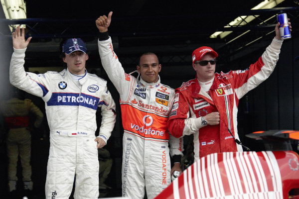 The fastest three qualifiers in parc ferme. L-R: Robert Kubica, 2nd position, pole sitter Lewis Hamilton and Kimi Räikkönen, 3rd position.