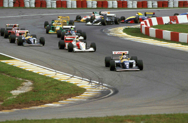 Alain Prost, Williams FW15C Renault, leads Ayrton Senna, McLaren MP4-8 Ford, Damon Hill, Williams FW15C Renault, J J Lehto, Sauber C12, Jean Alesi, Ferrari F93A (behind Hill's Williams), and Michael Schumacher, Benetton B193A Ford.