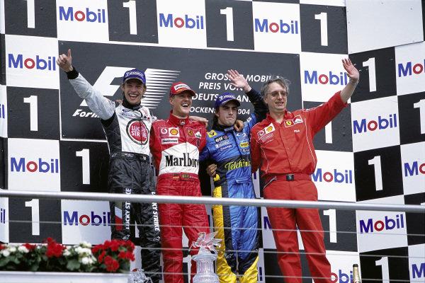 Winner Michael Schumacher celebrates on the podium with Jenson Button, 2nd position, Fernando Alonso, 3rd position and Ferrari engine designer Paolo Martinelli.
