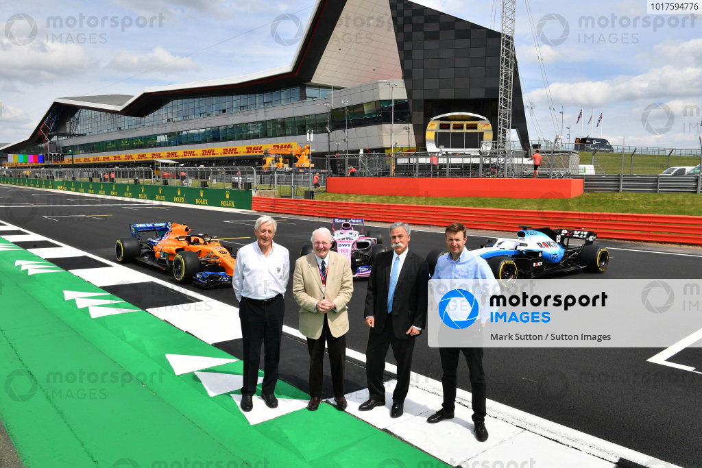 John Grant, Chairman of the BRDC, Paddy Hopkirk, Chase Carey, Chairman, Formula 1 and Stuart Pringle, Managing Director of Silverstone Circuits with the McLaren MCL34, Racing Point RP19 and Williams Racing FW42 in front of the Silverstone Wing