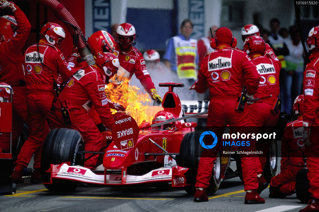 Michael Schumacher's Ferrari F2003-GA, catches fire during a pitstop.