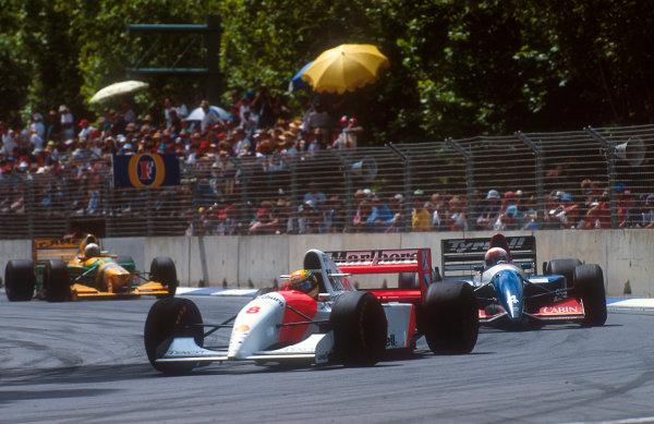 1993 Australian Grand Prix.Adelaide, Australia.5-7 November 1993.Ayrton Senna (McLaren MP4/8 Ford) 1st position, his last Grand Prix win, lapping Andrea de Cesaris (Tyrrell 021 Yamaha).Ref-93 AUS 21.World Copyright - LAT Photographic
