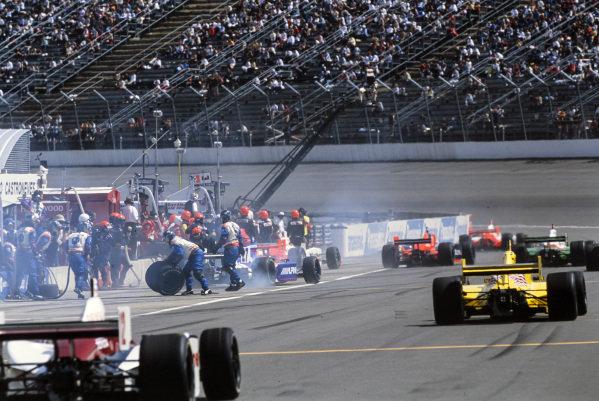 Cars make pitstops. Sam Hornish Jr, Panther Racing, Dallara IR-03 Chevrolet, drives down the pitlane, while Robby Gordon, Andretti Green Racing, Dallara IR-03 Honda, completes his.