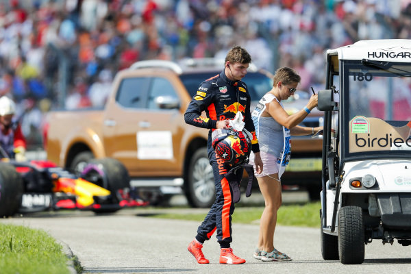 Max Verstappen, Red Bull Racing, gets a lift back to the pits after retiring from the race.