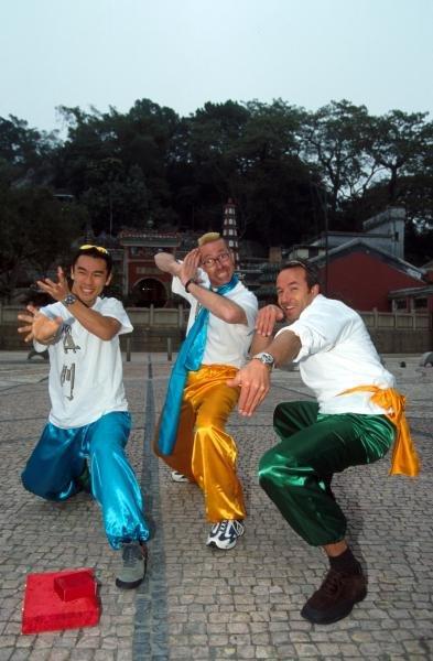 Winner of the Macau GP, Takuma Sato (JPN), left, strikes a martial arts pose with touring car driver Tom Coronel (NED), right. 48th Macau Grand Prix, Macau, 18 November 2001 BEST IMAGE