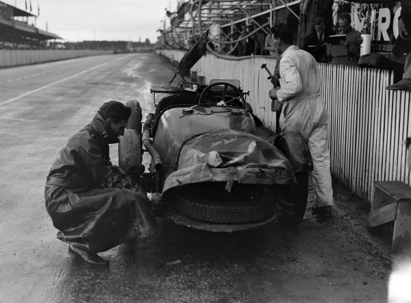 The heavily damaged Aston Martin 1.5 of Clifton Penn-Hughes / Thomas Fotheringham-Parker in the pits after an accident that led to its retirement.