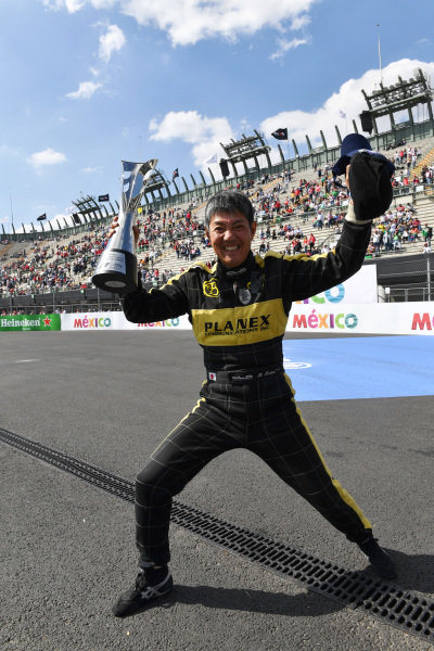 Race winner Katsuaki Kubota (JPN) celebrates with the trophy at Masters Historics, Circuit Hermanos Rodriguez, Mexico City, Mexico, 29 October 2016.