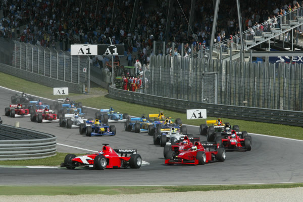 2002 F3000 ChampionshipA1-Ring, Austria. 11th May 2002.Tomas Enge leads away from the start from the two Coloni drivers, Pantano and Toccacelo who fight for position.World Copyright: LAT Photographicref: Digital Image Only
