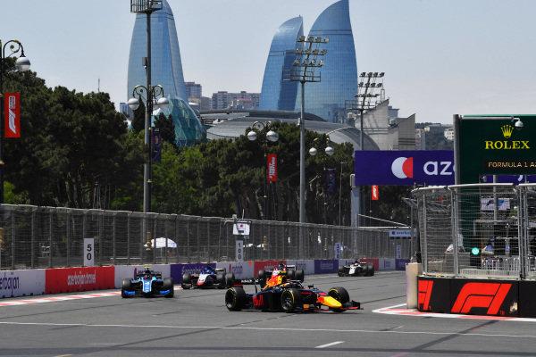 Juri Vips (EST, Hitech Grand Prix), leads Felipe Drugovich (BRA, Uni-Virtuosi), amd David Beckmann (DEU, Charouz Racing System)